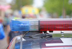 Flashing lights on the police car on patrol Stock Photos
