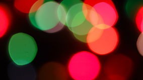 Flashing of medium size bright blurred festive and colorful Christmas lights stock video
