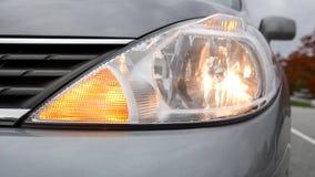 Flashing orange blinker light on front lamp stock video