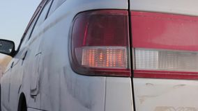 Flashing orange blinker light on rear lamp. car on a sidelines stock video footage