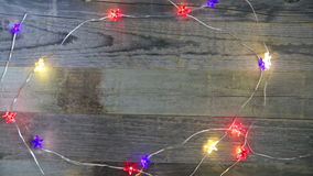 Flashing Patriotic Lights. Flashing red, white and blue lights on wooden surface with copy space stock video