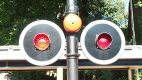 Flashing red lights level crossing stock video