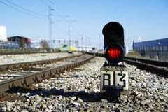 Flashing red railway traffic light. Traffic light on the railroad flashing red prohibiting the train passing Royalty Free Stock Photos