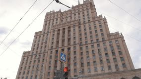 Flashing red traffic light in front of Moscow State University building stock video