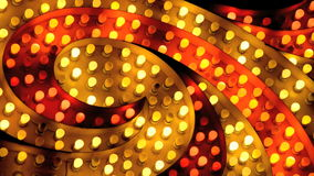 Flashing red and yellow marquee spiral stock footage
