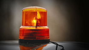 Flashing revolving light on top of a police, firemen, hospital emergency support and services vehicles