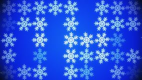 Flashing and rotating snowflakes in white on blue. In backgrounds stock video footage