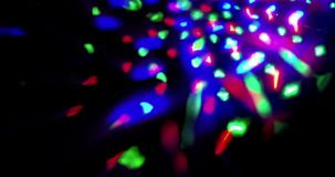 Flashing shiny multicolor stage lights circular movement entertainment disco dance, spotlight projectors in the dark, colorful stock footage