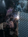 Flashing, smoking, sparking of a welding process. Royalty Free Stock Photography