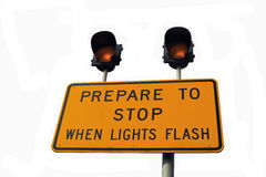 Flashing Warning Stop Sign. Prepare to stop when lights flash warning sign Stock Photo
