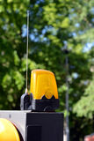 Flashing yellow light of automatic road barrier Royalty Free Stock Photo