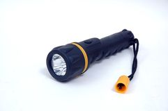 Flashlight. Yellow Ring Black Flashlight, Light is On; isolated, clipping path included Stock Images