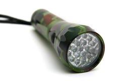 Flashlight. Camouflage flashlight isolated on white Royalty Free Stock Image