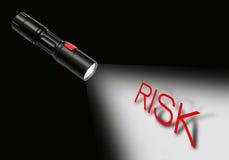 Flashlight beam to risk Royalty Free Stock Image