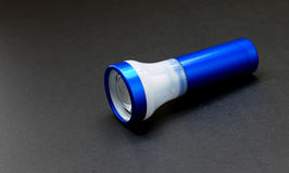 Flashlight on black table Stock Image