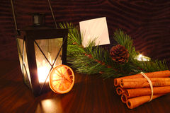 Flashlight candle with white paper, orange, cinnamon and pine branch Royalty Free Stock Image