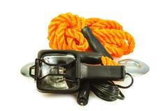 Flashlight and car tow rope Stock Photos