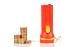 Flashlight and coin Stock Images