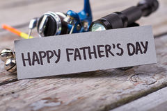Flashlight and Father`s Day card. Stock Photography