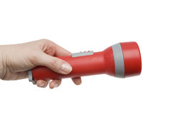 Flashlight in a female hand Royalty Free Stock Images