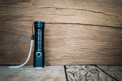 Flashlight on grunge wood background. Stock Image