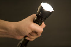 Flashlight in hand, royalty free stock photos