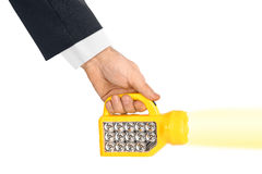 Flashlight in hand Royalty Free Stock Photos