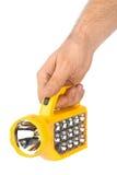 Flashlight in hand Stock Image