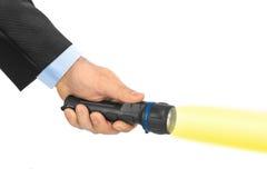 Flashlight in hand Stock Photos