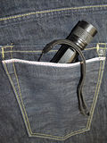 Flashlight in jeans pocket Stock Photography