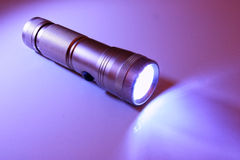 Flashlight and light ray. Light in the dark from a flash light Stock Photo