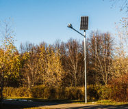 Flashlight on solar batteries in the autumn park. Horizontal photo, photo took in Moscow, Russia Royalty Free Stock Images