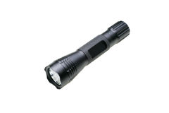 Flashlight or torch. A small, black flashlight, also called a torch, isolated on a white background Royalty Free Stock Images