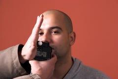 Flashmeter, test on model. Holding a flashmeter, test on model Royalty Free Stock Photos