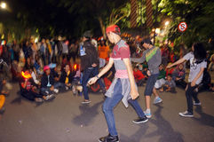 Flashmob. Teens dancing flashmob while celebrating the new year 2015 in the city of Solo, Central Java, Indonesia Royalty Free Stock Photography