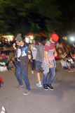 Flashmob. Teens dancing flashmob while celebrating the new year 2015 in the city of Solo, Central Java, Indonesia Royalty Free Stock Photos