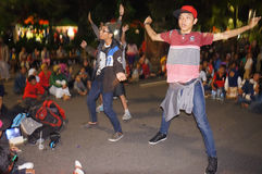 Flashmob. Teens dancing flashmob while celebrating the new year 2015 in the city of Solo, Central Java, Indonesia Royalty Free Stock Photo