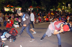 Flashmob. Teens dancing flashmob while celebrating the new year 2015 in the city of Solo, Central Java, Indonesia Stock Photo