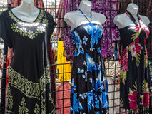 Flashy dresses. Garish dresses at a street fair stock photos