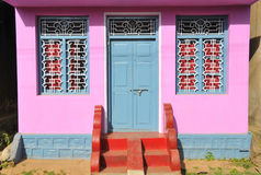 Flashy home. A little house recently painted in bright colors ... with steps and motorcycle ramp ... Karnataka,India Stock Photography