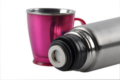Flask. Opened Metal flask with pink colour cop Stock Photo