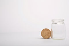 Flask with cork beside it Royalty Free Stock Image