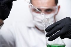 The scientist conducts an experiment. royalty free stock photography
