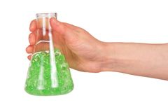 Flask with green substance in hand Royalty Free Stock Image