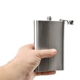 Flask in hand Stock Image