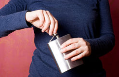 Flask in hands. Young woman opens flask in her hands. Problems with alcohol concept Royalty Free Stock Photos