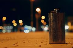 Flask on the night train station Stock Photography