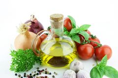 Flask of oil with herbs. Stock Photos
