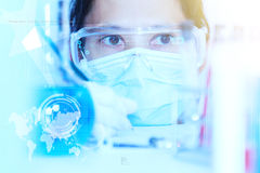 Flask in scientist hand with test tubes for analysis. Royalty Free Stock Images