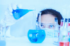 Flask in scientist hand with test tubes eyes focus for analysis. Stock Photography